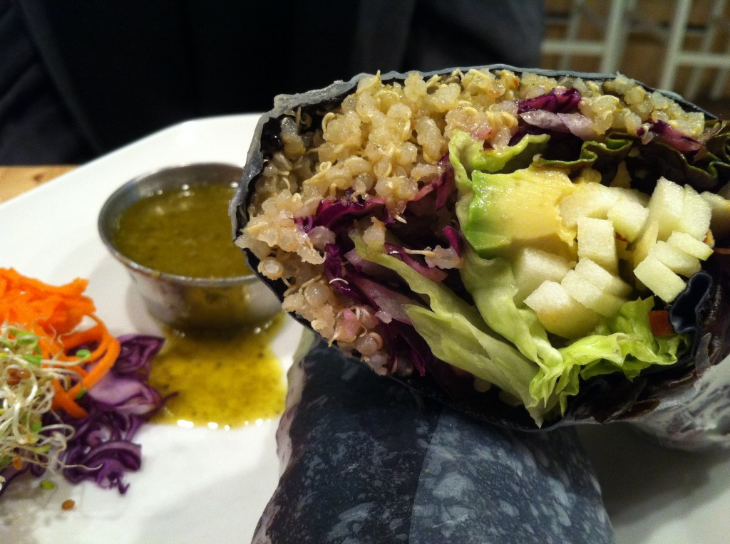 Cooked Quinoa Wrapped in Nori and Rice Sheets, Garnished With Lettuce, Sprouts and Vegetables WIth Coconut Feta, Apple and Arugula