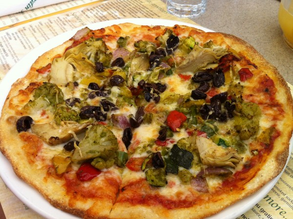 Pizza with Garden Vegetables, Olives, Garlic, Pesto, Cheddar, Mozzarella, Parmesan