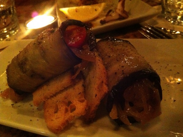 Stuffed roasted eggplant and onion confit with dill parsley and cherry tomato