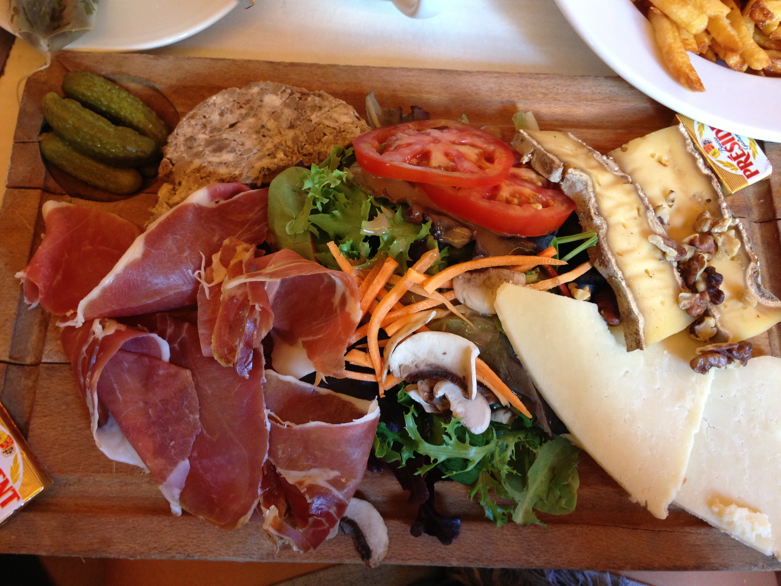 2 Moulins Charcuterie Board: Serrano Ham, Terrine from Auvergne, Cheese, Cantal Cheese, Walnuts, Salad
